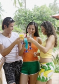 Young adults with drinks, toasting - Asia Images Group