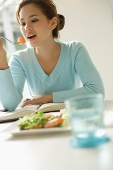 Young woman eating salad - Asia Images Group