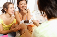 Young women at home, celebrating birthday - Asia Images Group