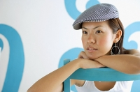 Young woman wearing beret, looking away - Asia Images Group