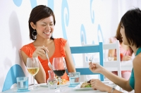 Young women having lunch in cafe - Asia Images Group