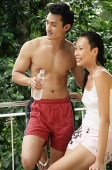 Couple in casual clothing, looking away - Asia Images Group