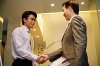 Businessmen shaking hands - Asia Images Group
