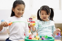 Girls playing with fishing game - Asia Images Group