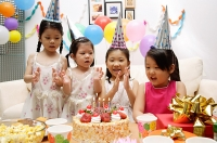 Four girls celebrating birthday - Asia Images Group