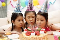 Three girls celebrating a birthday - Asia Images Group