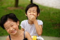Young girls in playground, laughing - Asia Images Group