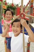 Two girls in playground, looking at camera - Asia Images Group