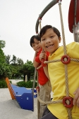 Two boys in playground, looking at camera - Asia Images Group