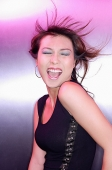 Woman with eyes closed, mouth open, with wind blown hair - Asia Images Group