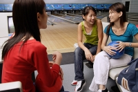 Women sitting in bowling alley - Asia Images Group