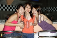 Women with drinks, smiling at camera - Asia Images Group