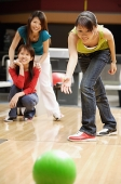 Woman bowling - Asia Images Group