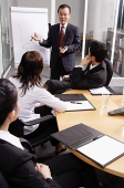 Businessman presenting to colleagues - Asia Images Group