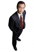 Businessman standing, looking at camera - Asia Images Group