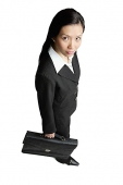 Businesswoman holding briefcase, looking at camera - Asia Images Group