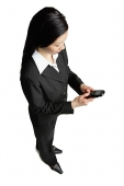 Businesswoman looking at mobile phone - Asia Images Group