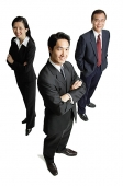 Executives standing, smiling at camera - Asia Images Group