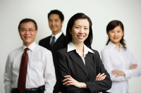 Executives standing together, arms crossed - Asia Images Group