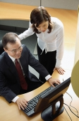 Two business people looking at computer - Asia Images Group