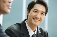 Businessman smiling - Asia Images Group