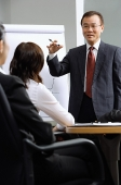 Businessman giving presentation colleagues - Asia Images Group