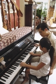 Father and daughter playing piano - Asia Images Group