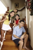 Family of four at home - Asia Images Group