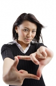 Young woman making hand sign - Asia Images Group