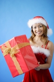 Woman in Santa hat, holding gift box - Asia Images Group