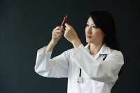Female doctor preparing syringe - Asia Images Group