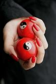 Woman holding Yin Yang balls - Asia Images Group
