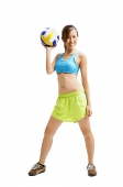 Young woman holding volleyball, looking at camera - Asia Images Group