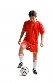Young man in soccer uniform with soccer ball - Asia Images Group
