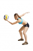 Young woman preparing to hit volleyball - Asia Images Group