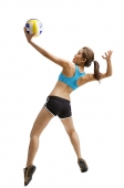 Young woman jumping, preparing to hit volleyball - Asia Images Group