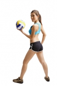 Young woman holding volleyball, looking over shoulder - Asia Images Group