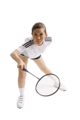 Young woman playing badminton, studio shot - Asia Images Group