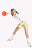 Young woman playing table tennis, studio shot - Asia Images Group