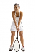 Young woman standing with tennis racket, smiling - Asia Images Group