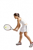 Young woman playing tennis, studio shot - Asia Images Group