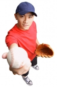 Young man wearing baseball glove and holding ball out to camera - Asia Images Group