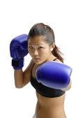 Young woman wearing boxing gloves - Asia Images Group