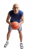 Young man holding basketball - Asia Images Group