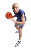 Young man holding basketball, preparing to shoot - Asia Images Group