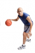 Young man dribbling basketball - Asia Images Group