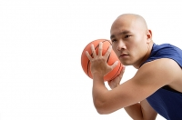 Young man playing basketball - Asia Images Group