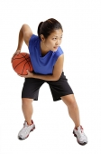 Young woman playing basketball - Asia Images Group
