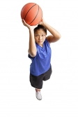 Young woman with basketball, aiming for a shoot - Asia Images Group