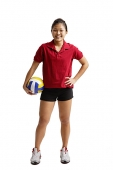 Young woman holding volleyball, smiling at camera - Asia Images Group